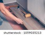 working with hands installs a... | Shutterstock . vector #1059035213