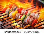 vegetable spit on grill flames... | Shutterstock . vector #105904508