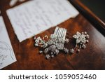 bride's jewelry lie on a wooden ... | Shutterstock . vector #1059052460