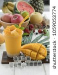 mango juice and mango on wood... | Shutterstock . vector #1059053774