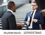 young delegate or broker in...   Shutterstock . vector #1059057860