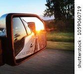looking in the rearview mirror  ... | Shutterstock . vector #1059060719