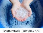 soap foam in the hands of the...   Shutterstock . vector #1059069773