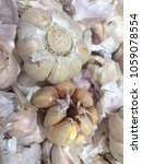 Small photo of White garlic pile texture. Fresh garlic on market table closeup photo. Vitamin healthy food spice image. Spicy cooking ingredient picture. Pile of white garlic heads. White garlic head heap top view