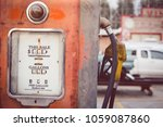 aged and worn vintage gas pump | Shutterstock . vector #1059087860