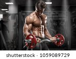 muscular man working out in gym ...   Shutterstock . vector #1059089729