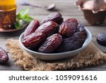 fresh medjool dates in a bowl... | Shutterstock . vector #1059091616