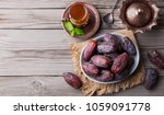fresh medjool dates in a bowl... | Shutterstock . vector #1059091778