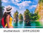 adventure traveler woman with...   Shutterstock . vector #1059120230