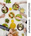 family dinner from above | Shutterstock . vector #1059125900