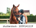 young teenage girl equestrian... | Shutterstock . vector #1059141119