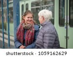 two women  old and young   sit... | Shutterstock . vector #1059162629