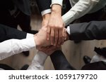 motivated business people put... | Shutterstock . vector #1059179720