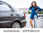 woman stand near scratched auto.... | Shutterstock . vector #1059186113