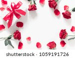 Stock photo white office table red rose rose petals a gift with a red bow valentine s day birthday happy 1059191726