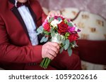 stylish groom with a bouquet of ... | Shutterstock . vector #1059202616