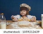 indoor shot of adorable baby...   Shutterstock . vector #1059212639