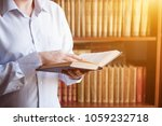 closeup view of book in man's... | Shutterstock . vector #1059232718