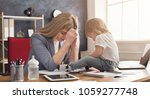 tired business mom working in...   Shutterstock . vector #1059277748