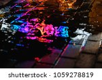 a puddle on a rainy night in...   Shutterstock . vector #1059278819
