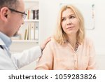 serious doctor consulting and... | Shutterstock . vector #1059283826