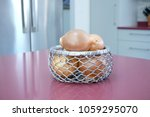 onions in a decorative woven...
