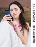 beautiful girl in bed clicks on ... | Shutterstock . vector #1059295496