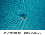 Aerial View Of Swimming Woman...
