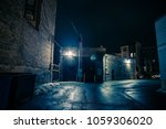 dark and eerie urban city alley ... | Shutterstock . vector #1059306020