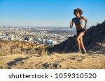 fit african american woman... | Shutterstock . vector #1059310520