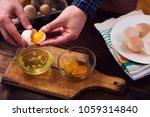 Separated Eggs Over Dark Brown...