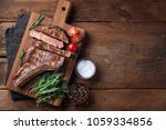 grilled cowboy beef steak ... | Shutterstock . vector #1059334856