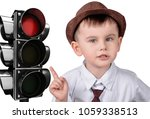a little boy is pointing at a... | Shutterstock . vector #1059338513