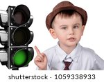 a little boy is pointing at a... | Shutterstock . vector #1059338933