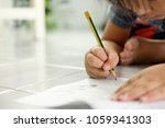 asian boy is writing the... | Shutterstock . vector #1059341303