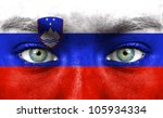 human face painted with flag of ... | Shutterstock . vector #105934334