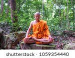 buddha monk sitting close his... | Shutterstock . vector #1059354440