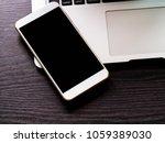 blank screen phone on  keyboard ... | Shutterstock . vector #1059389030