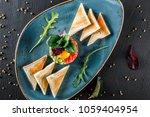 beef tartare served with an egg ... | Shutterstock . vector #1059404954