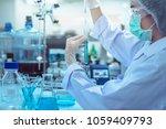 laboratory scientist working at ... | Shutterstock . vector #1059409793