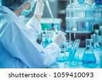 laboratory scientist working at ... | Shutterstock . vector #1059410093