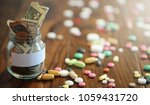 drugs and coins in a glass jar...   Shutterstock . vector #1059431720