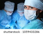 closeup of surgeons performing... | Shutterstock . vector #1059433286