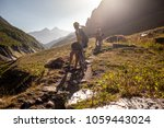 cyclists rest in the mountains... | Shutterstock . vector #1059443024