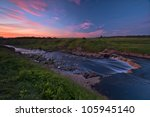 Small photo of Tosna river riffle adown in twilight