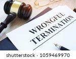 Small photo of Documents about wrongful termination and gavel.