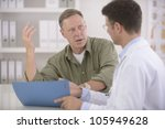 doctor talking to mature male... | Shutterstock . vector #105949628