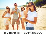 young nice girl with beer.... | Shutterstock . vector #1059501920