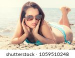 young woman in swimsuit at sea... | Shutterstock . vector #1059510248
