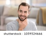 portrait of young man with... | Shutterstock . vector #1059524666
